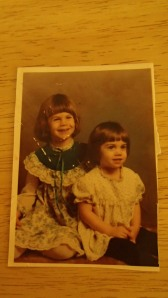 My sister and I, circa 1983. Notice the bowl cuts. That hairstyle was not kick ass.