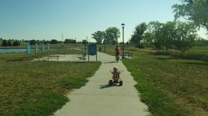Husband and preschooler, riding bikes