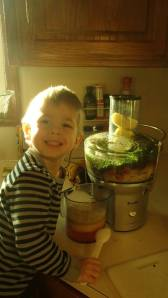 carrots, kale, apples, strawberries and lemon. He's one happy kid!